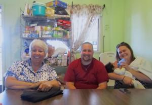 Orphanage founder Jenny Navarro (left) and houseparents, Brandon and Bethany Baird.